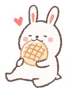 パンを食べているかわいいうさぎのイラスト